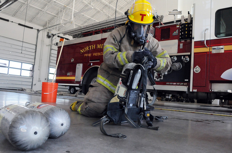 Trainee Lucas DeBroux performs various airpack exercises during testing day for the first class to complete their 16-week training at the North Metro Fire Rescue District Training Center on Friday.<br /> July 9, 2010<br /> Staff photo/ David R. Jennings