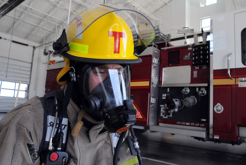 Trainee Lucas DeBroux in his breathing gear for a test during evaluation day for the first class to complete their 16-week training at the North Metro Fire Rescue District Training Center on Friday.<br /> July 9, 2010<br /> Staff photo/ David R. Jennings