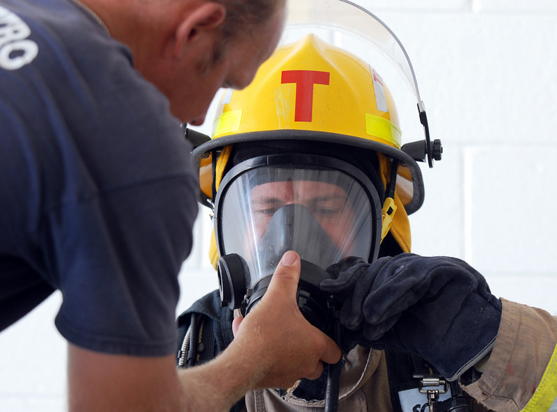 Fire trainee Shane Dougherty is tested on emergency procedures with his airpack by instructor Paul Nelson during evaluation day for the first class to complete their 16-week training at the North Metro Fire Rescue District Training Center on Friday.<br /> <br /> July 9, 2010<br /> Staff photo/ David R. Jennings