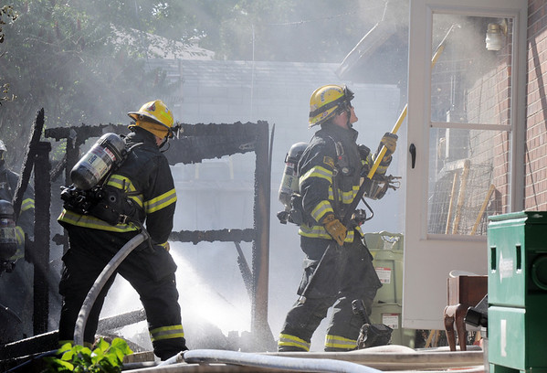 North Metro Fire Rescue firefighters extinguish a fire in the 700 block of Kalmia Way on Thursday. No injuries were reported. The cause of the fire is under investigation.<br /> August 11, 2011<br /> staff photo/ David R. Jennings