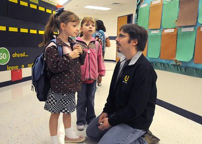 Duane Hess talks to his twin daughters Theresa, left, and, Sarah both 6, before going to their first grade class on the first day of school at Mountain View Elementary School on Wednesday.   August 19, 2009 staff photo/David R. Jennings