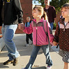 Twins Sarah, left and Theresa Hess, 6, hold hands lead by their father Duane Hess as they arrive for  the first day of school at Mountain View Elementary School on Wednesday. <br /> <br /> August 19, 2009<br /> staff photo/David R. Jennings