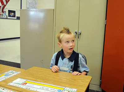 Ryan Woelfel, 5, waits at his desk for his first grade class to begin on the first day of school at Mountain View Elementary School on Wednesday.   August 19, 2009 staff photo/David R. Jennings