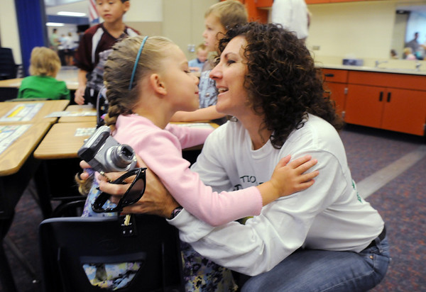 Terri Lucero, left, gives her daughter Delaney Osborn a hug and kiss before first grade class starts  on the first day of school at Mountain View Elementary School on Wednesday. <br /> <br /> August 19, 2009<br /> staff photo/David R. Jennings
