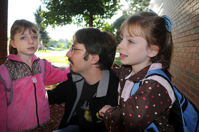 Duane Hess talks to his twin daughters Sarah, left, and Theresa, 6, outside of the school before going to their first grade class on the first day of school at Mountain View Elementary School on Wednesday.   August 19, 2009 staff photo/David R. Jennings
