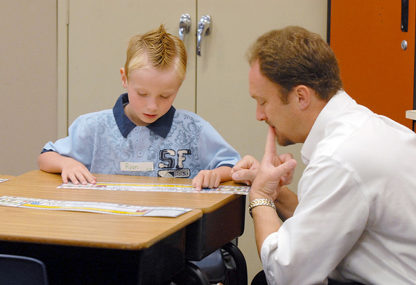 Ryan Woelfel, 5, left, and his father Jon look at Ryan's name plate on the first day of school at Mountain View Elementary School on Wednesday. <br /> <br /> August 19, 2009<br /> staff photo/David R. Jennings