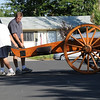 Al Hernandez, left, and Dan Stansbury roll a mortar in to place for display at the home of Dan's father, Skip, in Westlake on Saturday.<br /> <br /> Sept. 26, 2009<br /> Staff photo/David R. Jennings