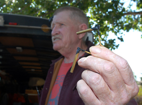 Skip Stansbury holds friction pins used to fire cannons at his home in Westlake. Stansbury runs the living history and the historic weapons for the Long's Peak Scottish Irish Highland Festival in Estes Park.<br /> Sept. 26, 2009<br /> Staff photo/David R. Jennings