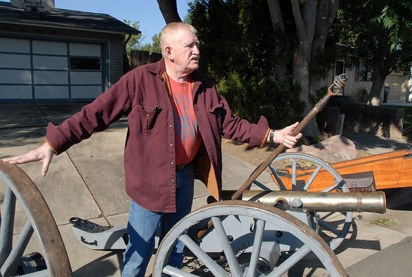 Skip Stansbury holds a tools used for cleaning a cannon barrel at his home  in Westlake on Saturday.<br /> Sept. 26, 2009<br /> Staff photo/David R. Jennings