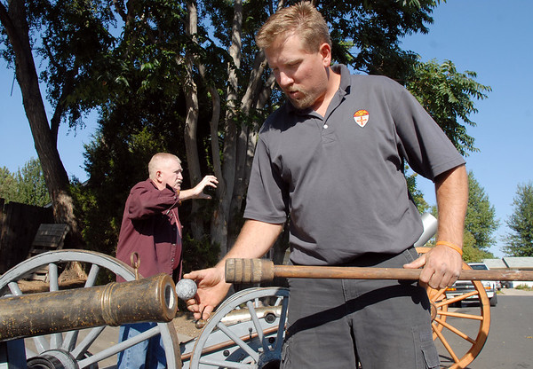Dan Stansbury, right, shows the lead ball for a hand make cannon by he and his father Skip, left, at their home in Westlake on Saturday.<br /> <br /> Sept. 26, 2009<br /> Staff photo/David R. Jennings