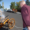 Skip Stansbury pulls a lanyard to fire the friction pin used to ignite the cannon powder in a cannon on display at his home  in Westlake on Saturday.<br /> <br /> Sept. 26, 2009<br /> Staff photo/David R. Jennings