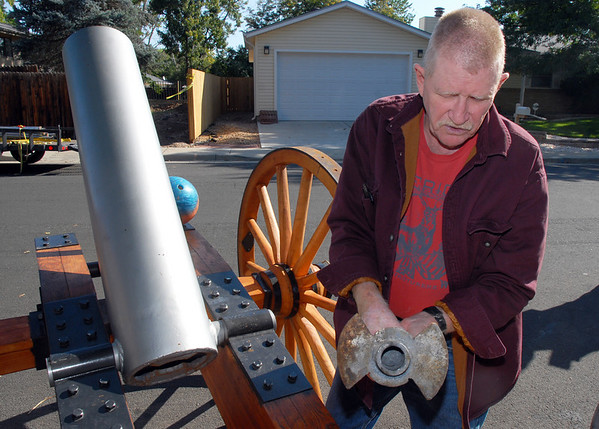 Skip Stansbury shows the cannon powder loading mechanism for his mortar in Westlake on Saturday. Stansbury runs the living history and the historic weapons at the Long's Peak Scottish Irish Highland Festival in Estes Park.<br /> <br /> <br /> Sept. 26, 2009<br /> Staff photo/David R. Jennings