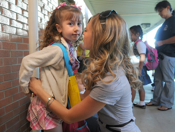Kindergartener Carrera Horan, left, gets a hug from her mother Holly before going to class on the first day of school at Emerald Elementary School on Thursday.<br /> <br /> August 20, 2009<br /> staff photo/David R. Jennings