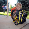 Jessie Bugaring huddles with his backpack while waiting to go to kindergarten class on the first day of school at Emerald Elementary School on Thursday.<br /> <br /> August 20, 2009<br /> staff photo/David R. Jennings