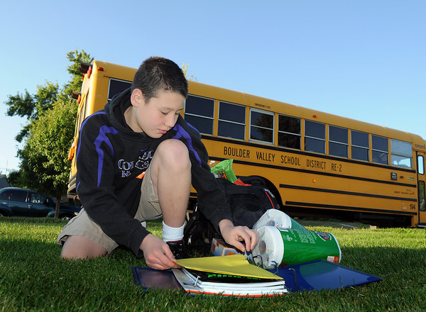 Fifth grader Sam Willett, 10, reorganizes his backpack before going to class on the first day of school at Emerald Elementary School on Thursday.<br /> <br /> August 20, 2009<br /> staff photo/David R. Jennings
