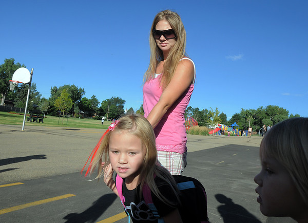 Kieley McClannahan, 6, leads her mother, Teresa, to the first grader's line on the first day of school at Birch Elementary School on Monday.<br /> <br /> August 15, 2011<br /> staff photo/ David R. Jennings