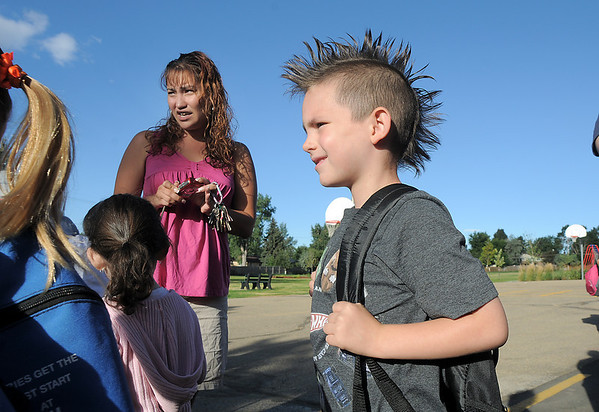Memo Uribes, 6, waits in line with his mother Katie nearby to start first grade on the first day of school at Birch Elementary School on Monday.<br /> <br /> August 15, 2011<br /> staff photo/ David R. Jennings