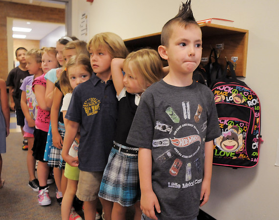 Memo Uribes, 6, prepares to lead his class of first graders to their classroom on the first day of school at Birch Elementary School on Monday.<br /> <br /> August 15, 2011<br /> staff photo/ David R. Jennings