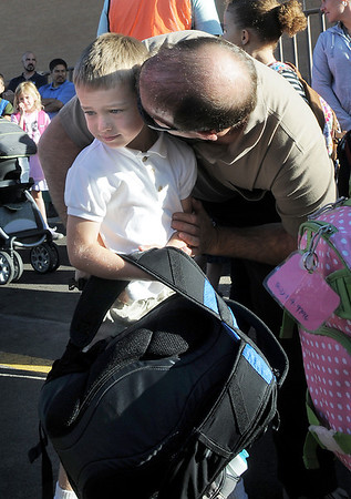 Adam Schatz gives his son Jeremy, 6, a hug and kiss while in line for first grade on the first day of school at Birch Elementary School on Monday.<br /> <br /> August 15, 2011<br /> staff photo/ David R. Jennings