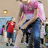 First grader Kaylee Syddall, 6, shows a scratch from camp to her teacher on the first day of school at Birch Elementary School on Monday.<br /> <br /> August 15, 2011<br /> staff photo/ David R. Jennings