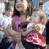 First grader Jasmine Lee, 6, holds her sister Isabella, 9 months-old, while standing in line on the first day of school at Birch Elementary School on Monday.<br /> <br /> August 15, 2011<br /> staff photo/ David R. Jennings