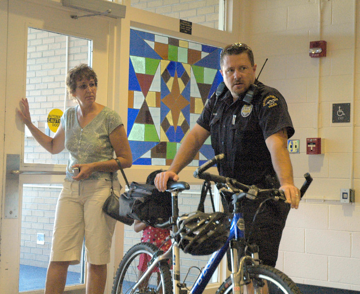 Debra Glennie leaves after speaking with school student resource officer, Doug Whiles at Westlake Middle School's freshman orientation 08/18/10. By Dylan Otto Krider