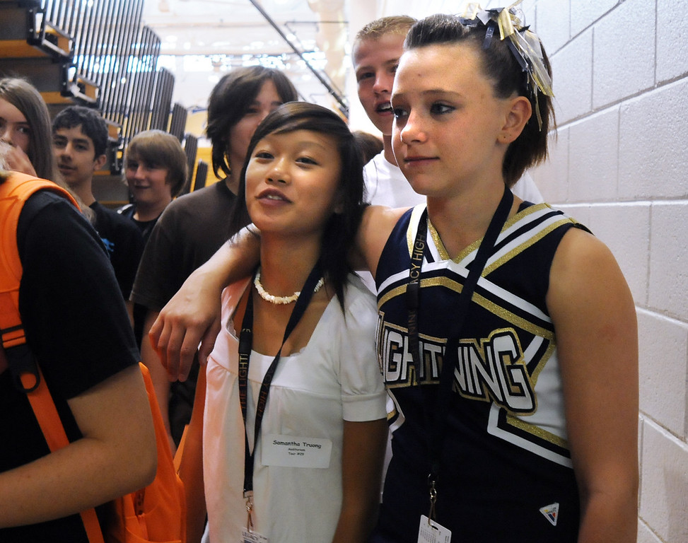 Freshmen Samantha Truong, left, and Cassandra van de Boogaard listen to their guide Preston Evans while taking a tour of Legacy High School on freshman orientation day on Wednesday. <br /> August 18, 2010<br /> staff photo/David R. Jennings