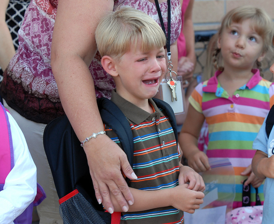 Kindergartener Ryan Gawlik is comforted by his teacher while waiting in line for class on the first day of school Wednesday at Coyote Ridge Elementary School. <br /> August 18, 2010<br /> staff photo/David R. Jennings