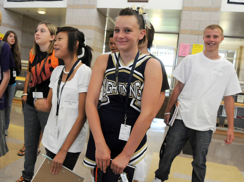 Freshmen Samantha Truong, left, and Cassandra van de Boogaard giggle as they listen to their guide Preston Evans while taking a tour of Legacy High School on freshman orientation day on Wednesday. <br /> August 18, 2010<br /> staff photo/David R. Jennings