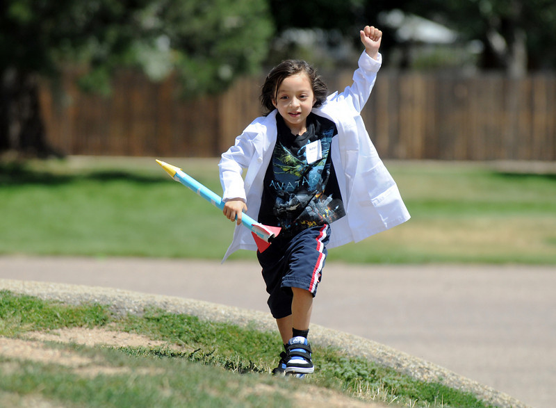 First grader Asher Gallegos-Montoya runs with the rocket he launched during class on the first day of the STEM (science, technology, engineering and math) lab school for Adams 12 Five Star School District in Northglenn on Wednesday.<br /> August 18, 2010<br /> staff photo/David R. Jennings