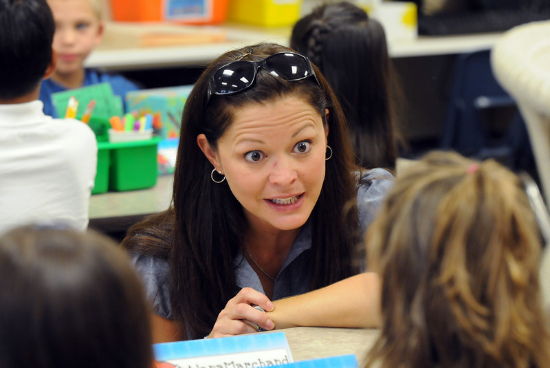 Coyote Ridge Elementary School's new principal Megan Cain talks to first graders on the first day of school, Wednesday. <br /> August 18, 2010<br /> staff photo/David R. Jennings
