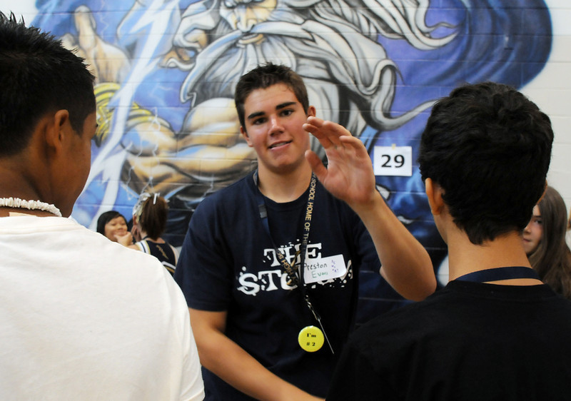 Preston Evans gives a high five to freshman in his tour group on orientation day  on Wednesday at Legacy High School. <br /> August 18, 2010<br /> staff photo/David R. Jennings
