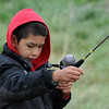 Tyson Perez, 8, tries to figure out his fishing line during Saturday's Fishing Derby at Tom Frost Reservoir.<br /> May 12, 2012 <br /> staff photo/ David R. Jennings