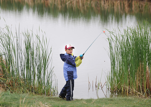 Will Tennyson, 7, fishes from the shore of Tom Frost Reservoir during Saturday's Fishing Derby.<br /> May 12, 2012 <br /> staff photo/ David R. Jennings