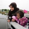 Anicee Lamoreaux, 8, right, fishes from the dock with her aunt Stacey Hunvald during Saturday's Fishing Derby at Tom Frost Reservoir.<br /> <br /> May 10, 2012 <br /> staff photo/ David R. Jennings