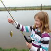 MaKenna Hardy, 10, poses with the fish she caught during Saturday's Fishing Derby at Tom Frost Reservoir.<br /> May 12, 2012 <br /> staff photo/ David R. Jennings