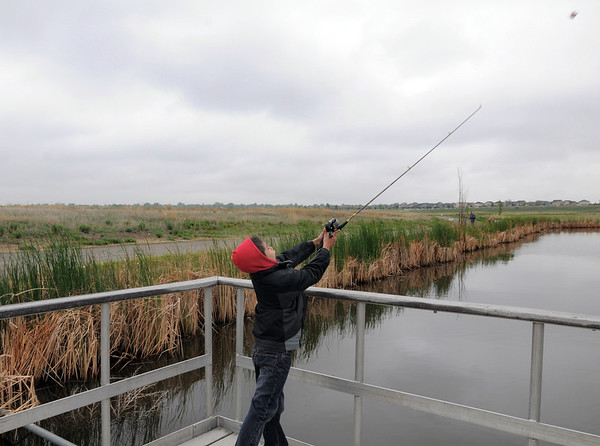 Tyson Perez, 8, casts his line from the dock at Tom Frost Reservoir during Saturday's Fishing Derby.<br /> May 12, 2012 <br /> staff photo/ David R. Jennings