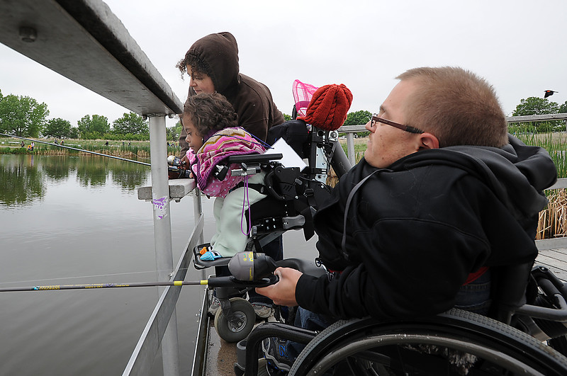 Anicee Lamoreaux, 8, left, fishes with her father, Chris Lamoreaux and her aunt Stacey Hunvald during Saturday's Fishing Derby at Tom Frost Reservoir.<br /> <br /> May 10, 2012 <br /> staff photo/ David R. Jennings
