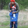 Scott gunderson helps his son Landon, 6, with casting practice during Saturday's Fishing Derby at Tom Frost Reservoir.<br /> May 12, 2012 <br /> staff photo/ David R. Jennings
