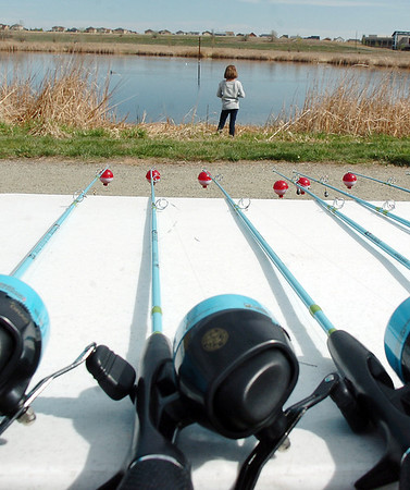 New fishing poles were given to children at Saturday's fishing derby at Tom Frost Reservoir  sponsored by the Broomfield Open Space Foundation in cooperation with the Colorado Division of Wildlife and the City and County of Broomfield.<br /> May 7, 2011<br /> staff photo/David R. Jennings