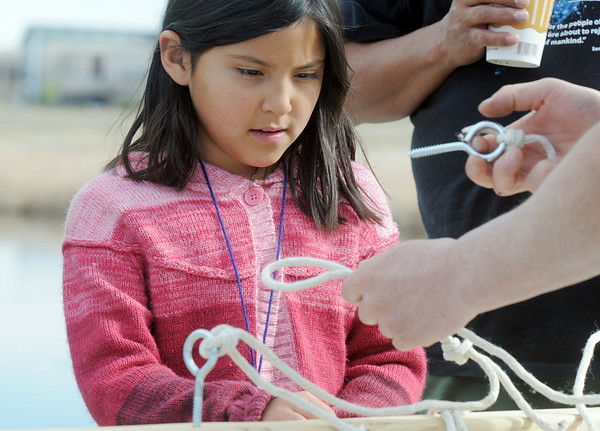 Oneida Leal, 7, learns to tie knots foe fishing during Saturday's fishing derby at Tom Frost Reservoir  sponsored by the Broomfield Open Space Foundation in cooperation with the Colorado Division of Wildlife and the City and County of Broomfield.<br /> May 7, 2011<br /> staff photo/David R. Jennings