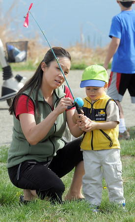 Bonnie Baxter helps her son Jonah, 2, to practice casting during Saturday's fishing derby at Tom Frost Reservoir  sponsored by the Broomfield Open Space Foundation in cooperation with the Colorado Division of Wildlife and the City and County of Broomfield.<br /> May 7, 2011<br /> staff photo/David R. Jennings
