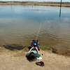 James Hall, 9, fishes while laying down on the shore during Saturday's fishing derby at Tom Frost Reservoir  sponsored by the Broomfield Open Space Foundation in cooperation with the Colorado Division of Wildlife and the City and County of Broomfield.<br /> May 7, 2011<br /> staff photo/David R. Jennings