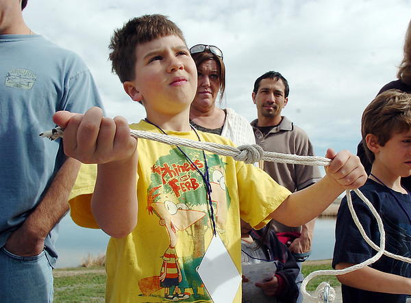Noah Douglass, 7, shows a knot he tied for fishing during Saturday's fishing derby at Tom Frost Reservoir  sponsored by the Broomfield Open Space Foundation in cooperation with the Colorado Division of Wildlife and the City and County of Broomfield.<br /> May 7, 2011<br /> staff photo/David R. Jennings
