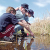 Jake Dunn, 7, left, looks a fish in the water with Robert Balzano and his son Matthew, 7, during Saturday's fishing derby at Tom Frost Reservoir  sponsored by the Broomfield Open Space Foundation in cooperation with the Colorado Division of Wildlife and the City and County of Broomfield.<br /> May 7, 2011<br /> staff photo/David R. Jennings