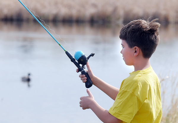 Noah Douglass, 7, fishes during Saturday's fishing derby at Tom Frost Reservoir  sponsored by the Broomfield Open Space Foundation in cooperation with the Colorado Division of Wildlife and the City and County of Broomfield.<br /> May 7, 2011<br /> staff photo/David R. Jennings
