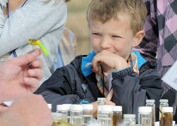 Brady Hoeben, 6, learns about fishing lures and insects during Saturday's fishing derby at Tom Frost Reservoir  sponsored by the Broomfield Open Space Foundation in cooperation with the Colorado Division of Wildlife and the City and County of Broomfield.<br /> May 7, 2011<br /> staff photo/David R. Jennings