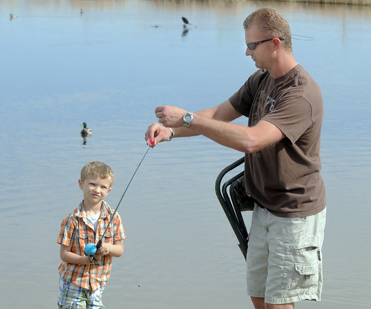 Brady Hoeben, 6, has a little help form his father Brad before casting during Saturday's fishing derby at Tom Frost Reservoir  sponsored by the Broomfield Open Space Foundation in cooperation with the Colorado Division of Wildlife and the City and County of Broomfield.<br /> May 7, 2011<br /> staff photo/David R. Jennings