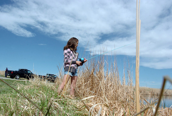 Kayley Hoeben, 11, fishes near the cattails along the shore during Saturday's fishing derby at Tom Frost Reservoir  sponsored by the Broomfield Open Space Foundation in cooperation with the Colorado Division of Wildlife and the City and County of Broomfield.<br /> May 7, 2011<br /> staff photo/David R. Jennings