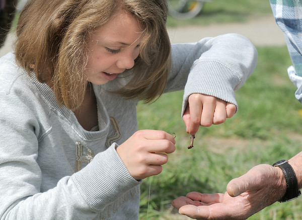 Emmy Hoeben, 9, puts a worm on her hook during Saturday's fishing derby at Tom Frost Reservoir sponsored by the Broomfield Open Space Foundation in cooperation with the Colorado Division of Wildlife and the City and County of Broomfield.<br /> May 7, 2011<br /> staff photo/David R. Jennings